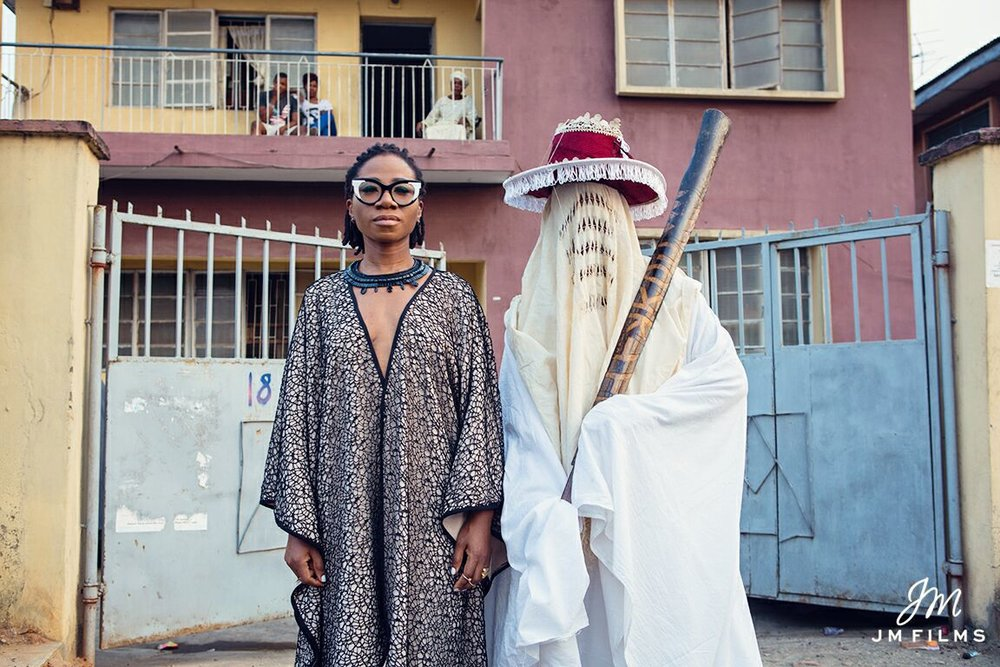 Nigerian Soul Artist Asa with an Eyo Masquerade; a major culture symbol of the Yoruba people / Via thestylehq