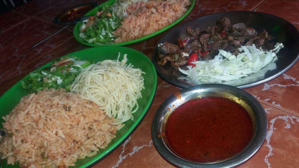 Jollof Rice, Spagetti, Salad and Diced beef, served with Spicy Sauce