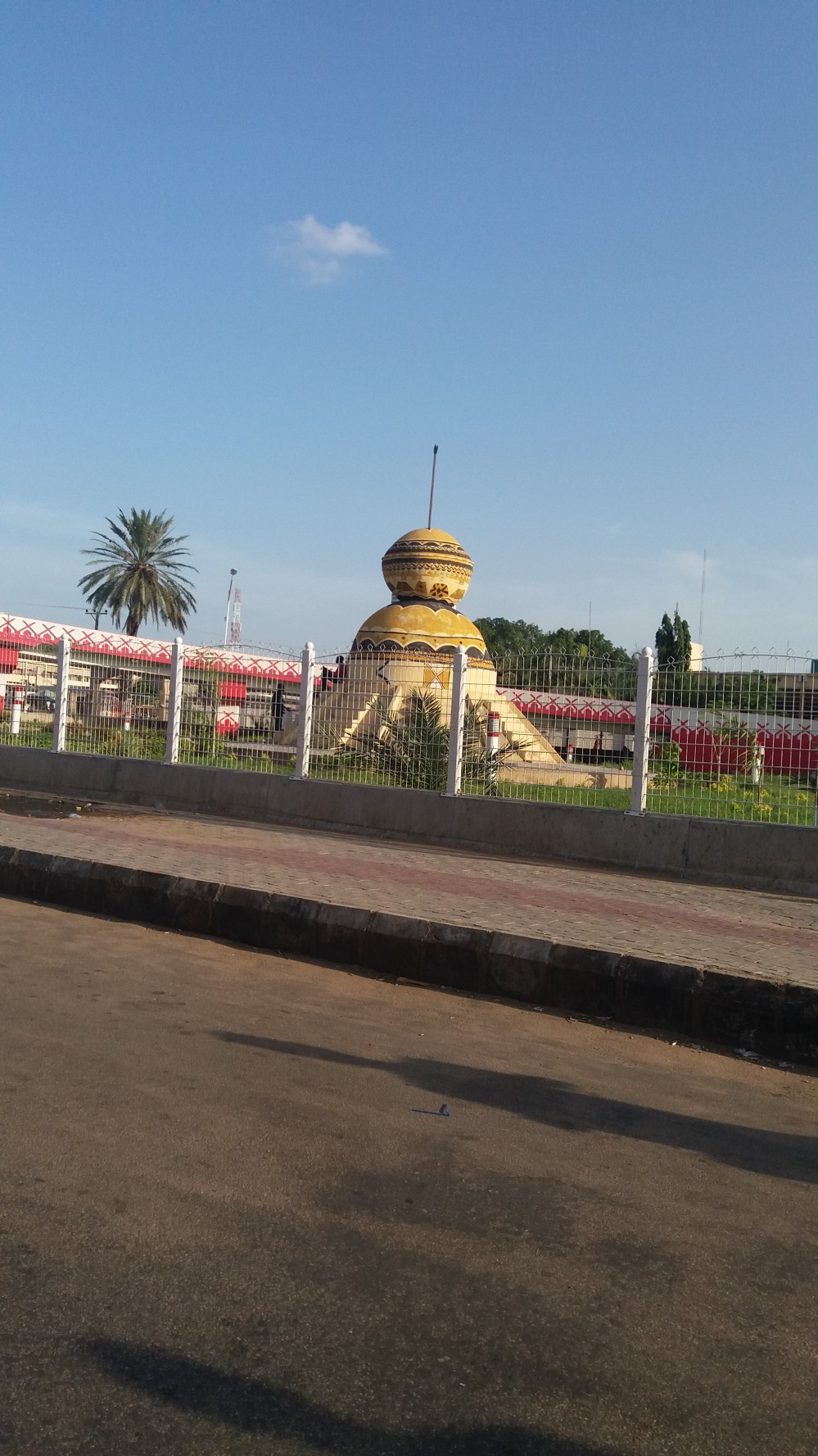 Street Monument representing Curved Calabash, Popularly used for storage and carriage of Fura D' Nunu