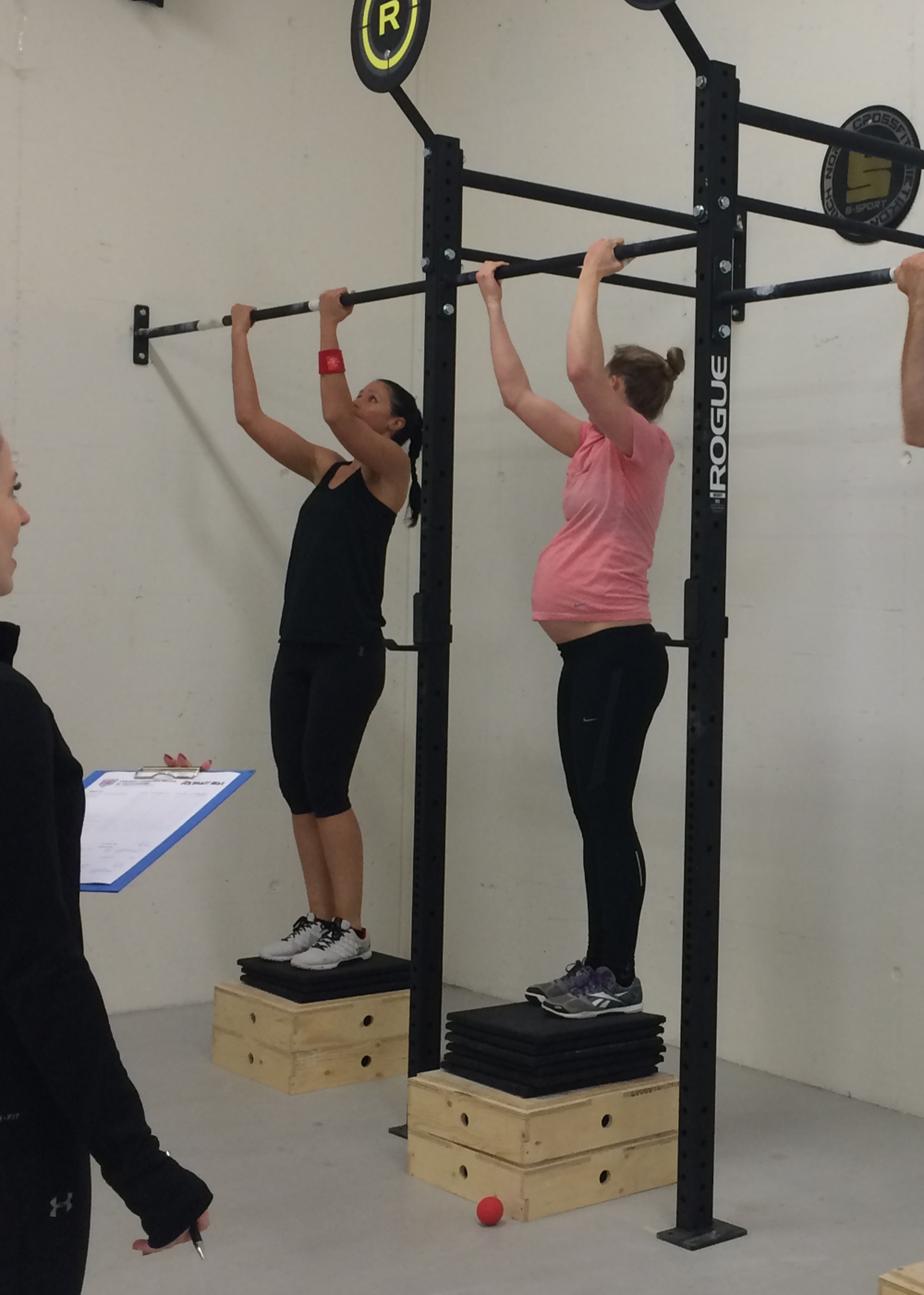Baba teaching others how to reach their first chest-to-bar pullup.