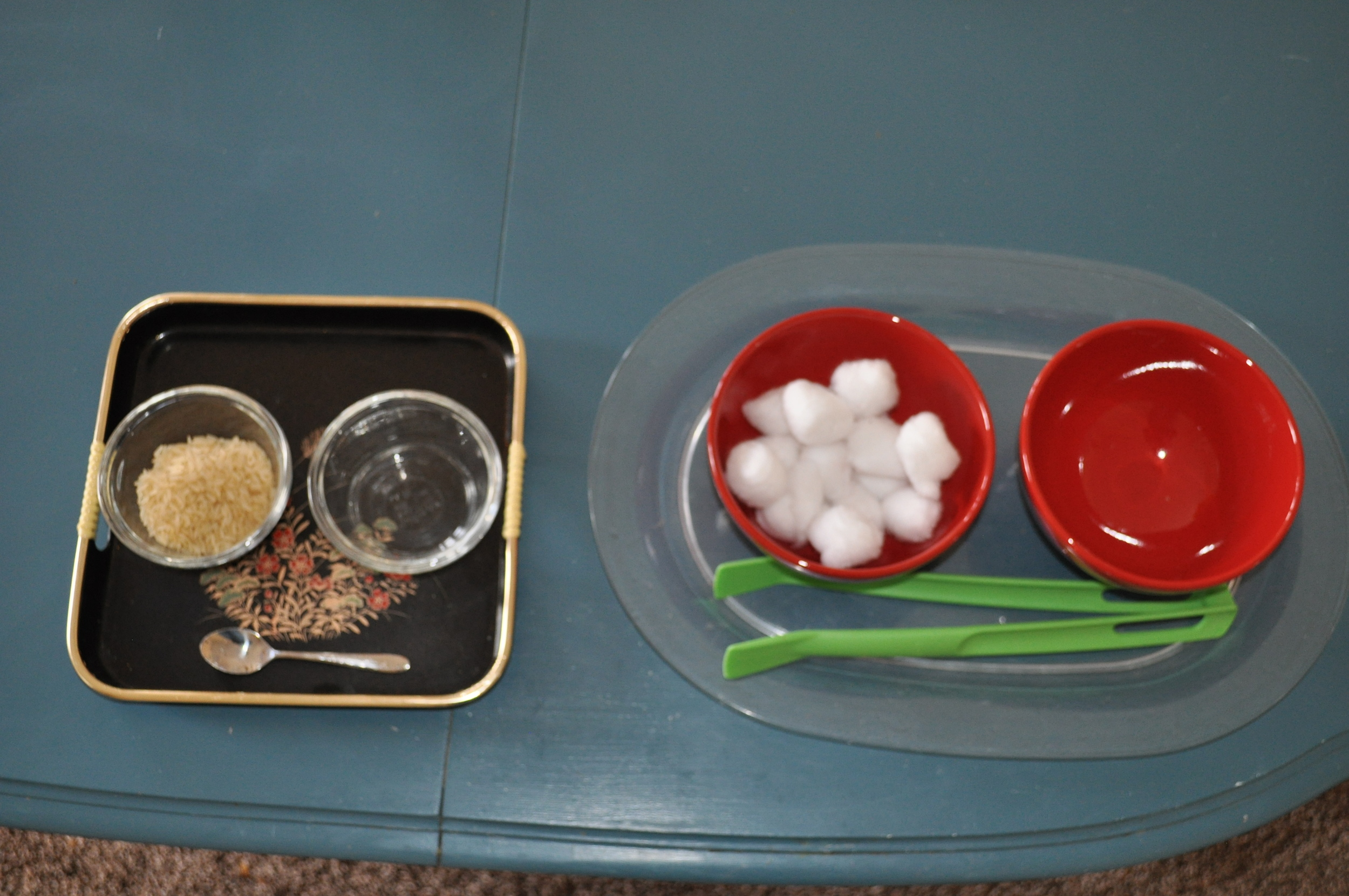 Two transferring activities.  The one on the left would be more difficult with rice and a small spoon than the one of the right with cotton balls and big tongs.