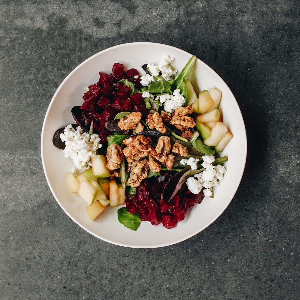 LOCAL ROOTS - Mixed greens, roasted beets, citrus-marinated fennel, local goat cheese, caramelized walnuts, lemon herb chicken, maple sherry dressing11.14