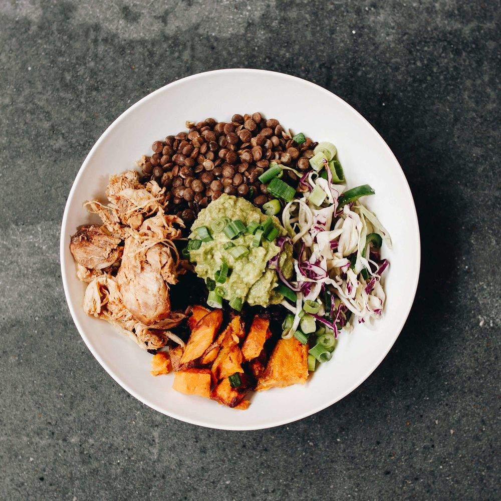 pOWER bowl - Forbidden black rice, rosemary lentils, roasted sweet potatoes, poblano slaw, green onion, house guacamole, jerk chicken, goddess dressing10.43