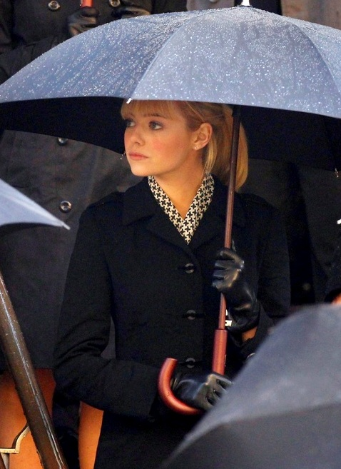 This set photo of Emma Stone from The Amazing Spider Man 2 is a fine example of classic  and understated funeral attire.