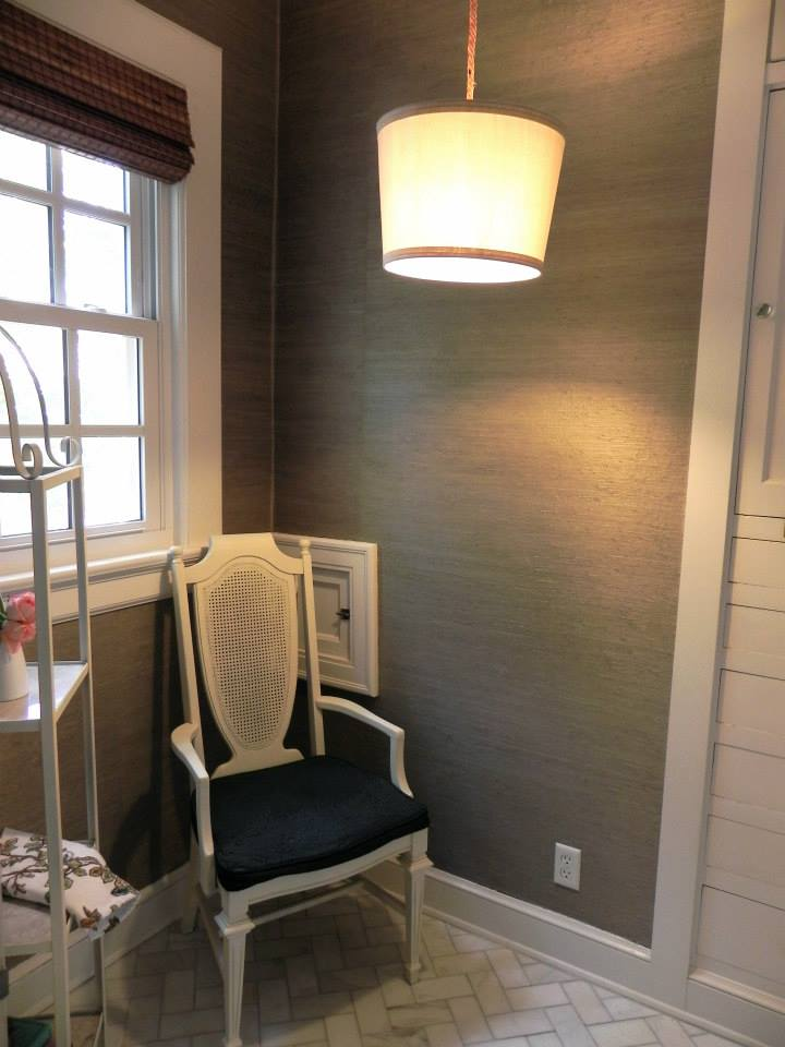 Classics like grasscloth and marble subway tile in a herringbone pattern feel right at home in this 1929 Lady's Dressing Room. Behind the chair, you'll notice the pass-thru laundry chute.