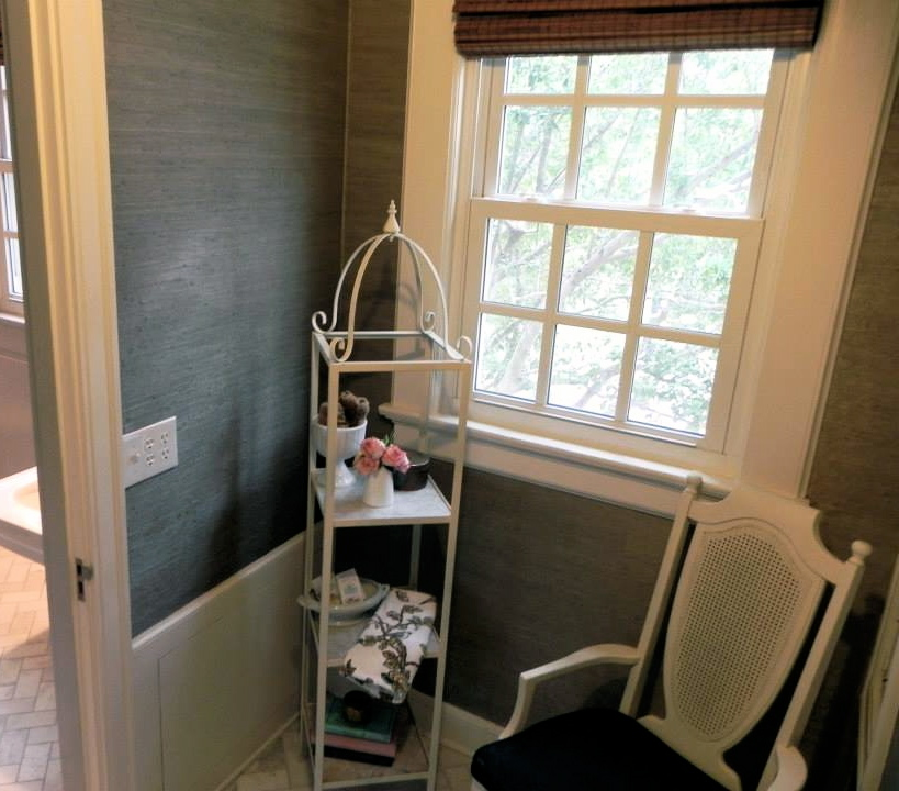 """My """"placeholder"""" folding table now sits under the window. The chair has been moved to my study, and the étagère has been moved upstairs to my children's bathroom."""
