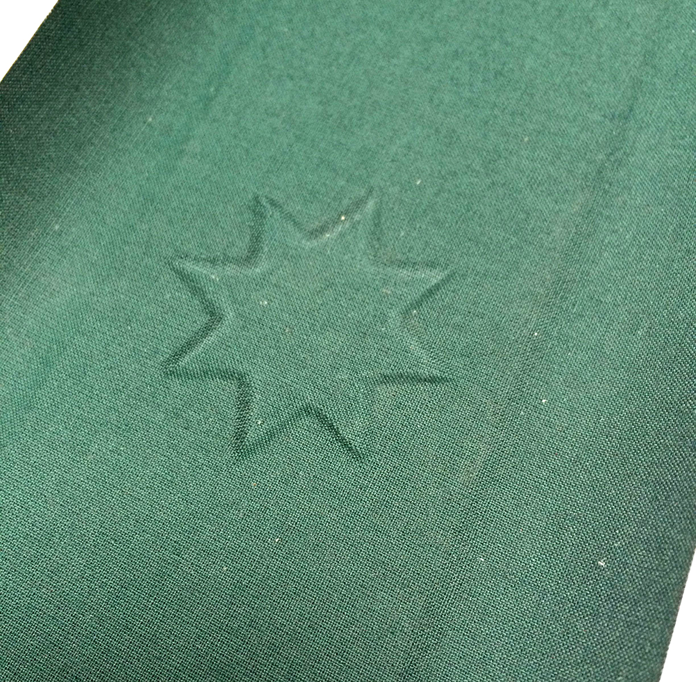 Embossed book cloth for the front cover - the shape will be filled with a metallic print of the star motif (shown in the next photo).