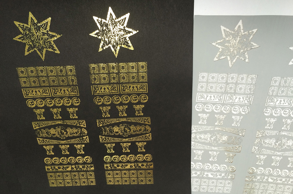 Gold foil heat transfer – laser printing black ink onto black paper and then running it through a laminator with the foil.
