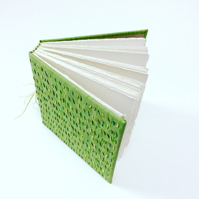 Multi-section book with embroidered cover