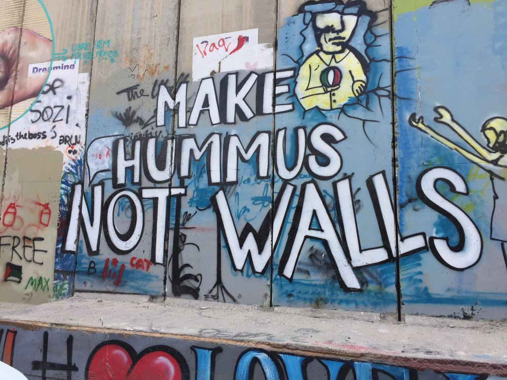 Art work on the Palestinian side of a border wall that separates Palestinian and Israeli controlled territories in Bethlehem.