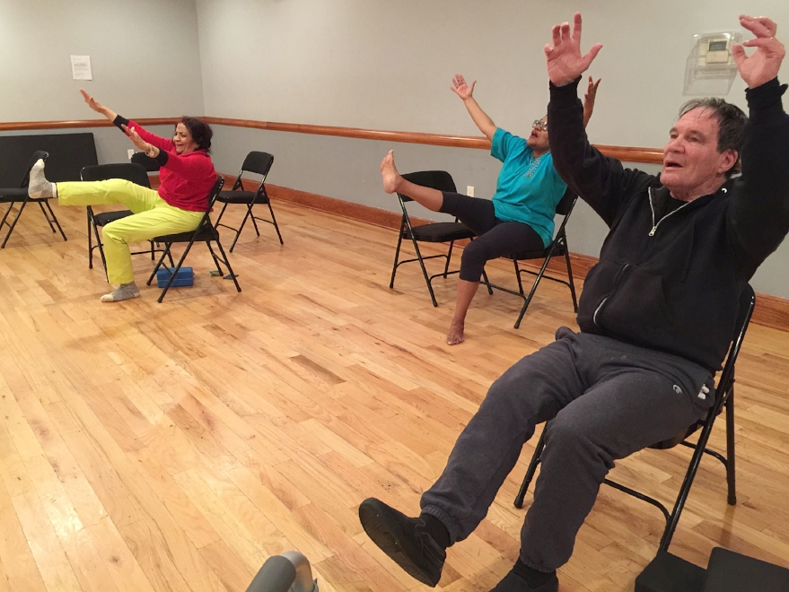My senior chair yoga students practicing seated Hanumanasana - forward splits posture. Yay, a little victory over the self, and our limited beliefs about our possibilities!