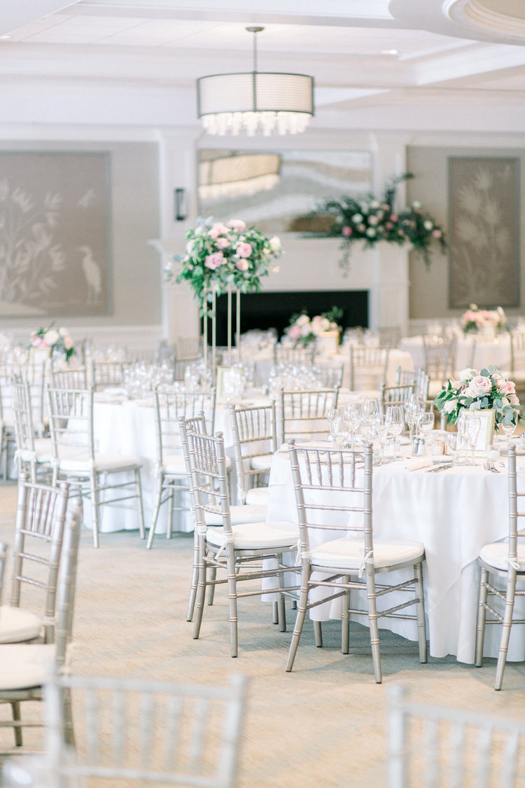 Shorehaven Golf Club wedding reception centerpieces tall low.jpg