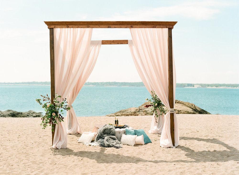 beach wedding chuppah arbor draping floral ceremony greens.jpg