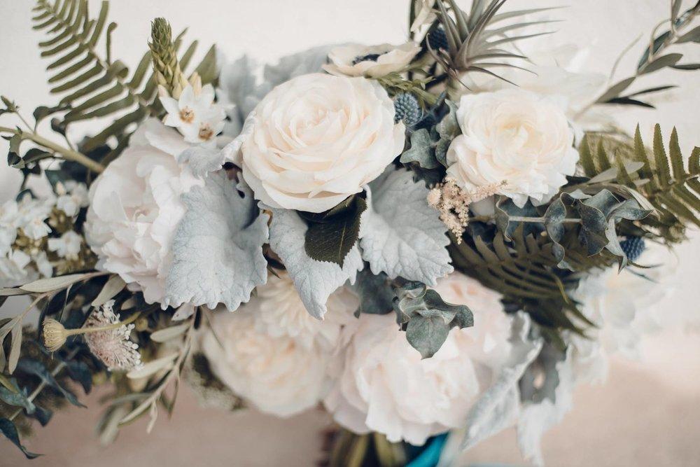 Woodstock Connecticut wedding bouquet detail blush blue roses thistle.jpg