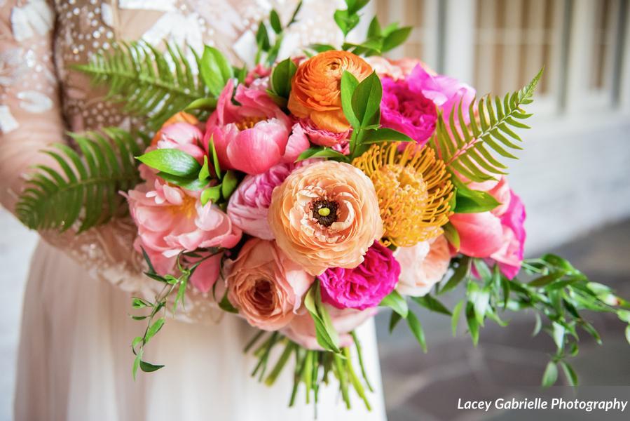 New Haven lawn club wedding bridal bouquet colorful bright tropical ranunculus peonies coral.jpg