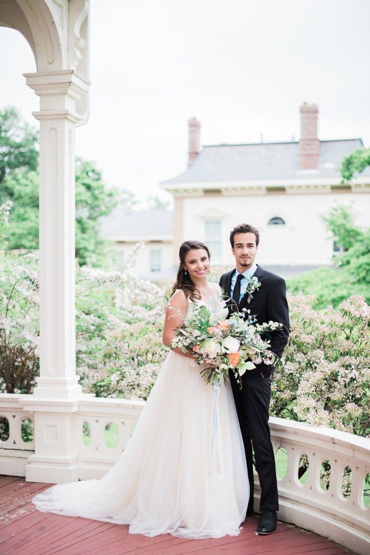 wedding outdoor bride and groom bridal bouquet boutonniere peach white blue.jpg