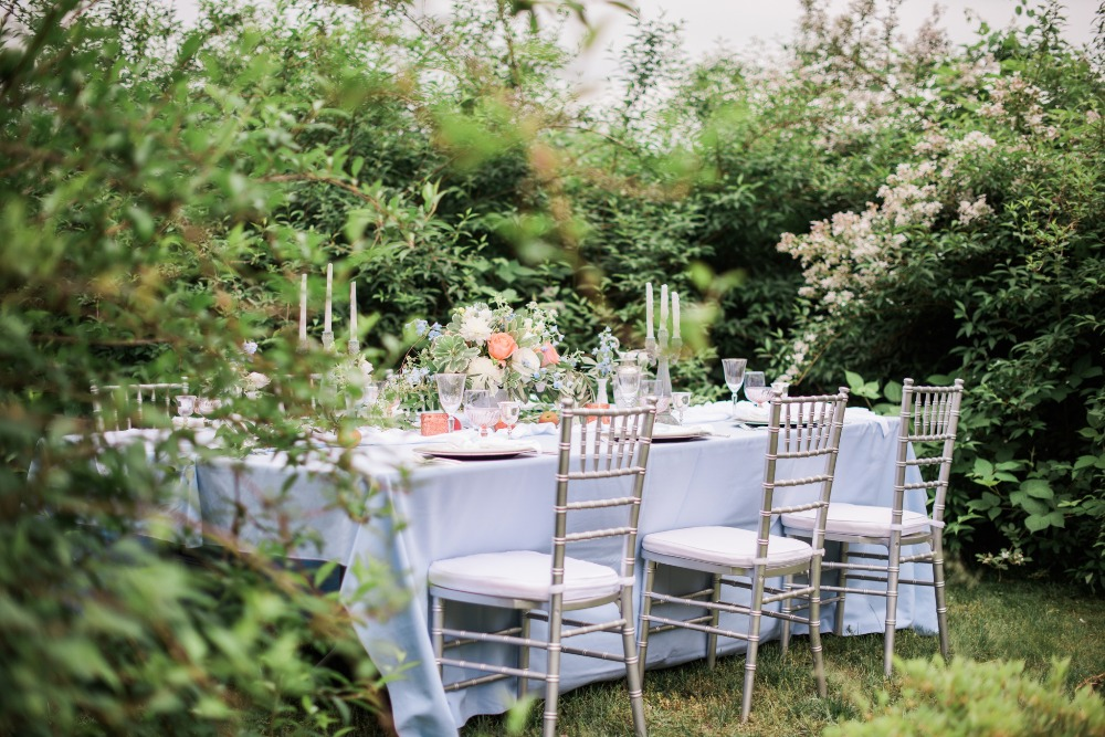 wedding table setting outdoor centerpiece coral blue candles.jpg