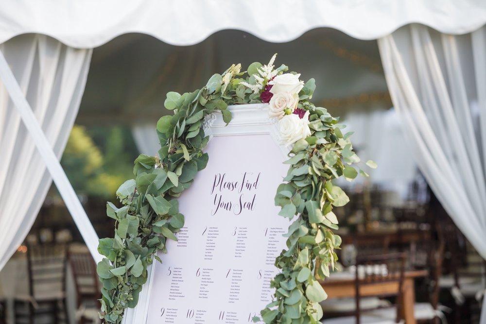 Preston Ridge Vineyard wedding escort display greens garland eucalyptus.jpg