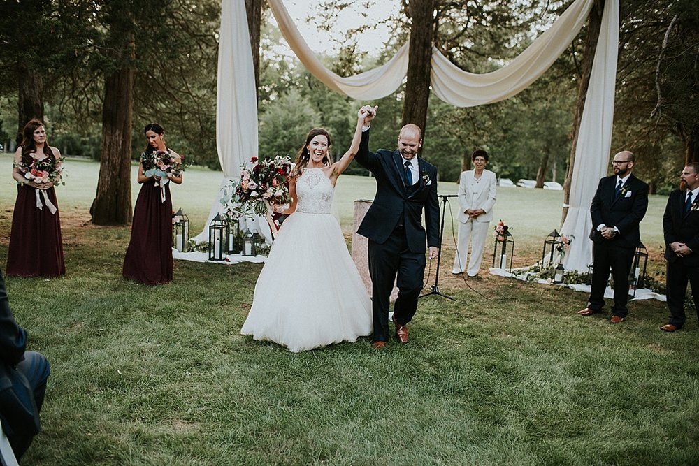 Wadsworth Mansion wedding ceremony bride and groom bridal bouquet draping.jpg