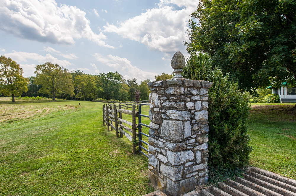 Bucolic pastures and split rail fencing surround the residence