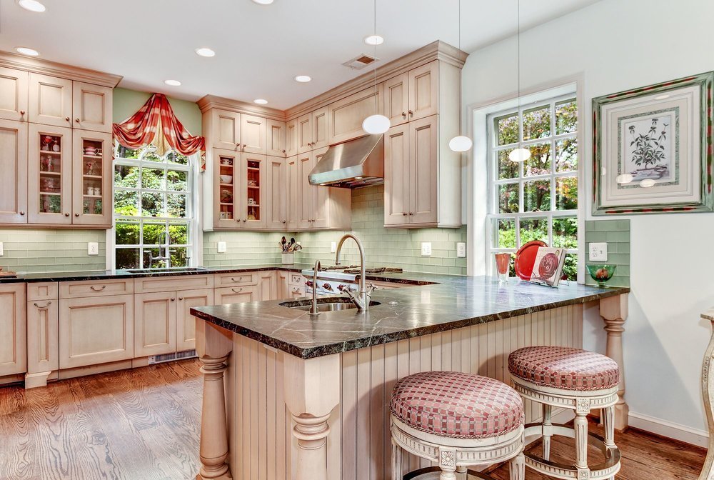 The Jennifer Gilmer Kitchen features a breakfast bar as well as a generous informal dining area