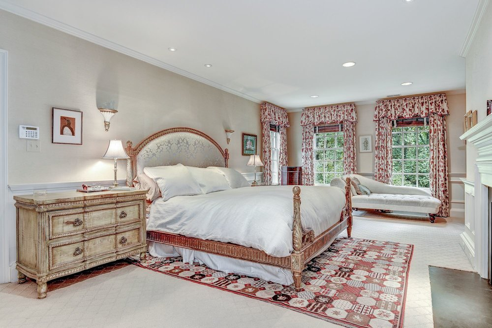 The spacious and private Master Bedroom offers a fireplace, windows with three exposures, ample closets, and an en suite bathroom