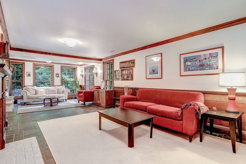 The Family Room offers a handsome slate floor, fireplace and access to the outdoors