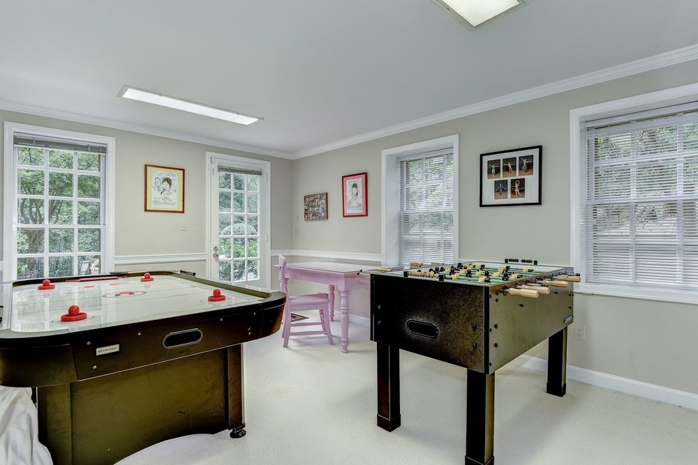 The Game Room with en suite full bathroom and walk-in closet may also serve as a home gym or as a bedroom with separate entrance