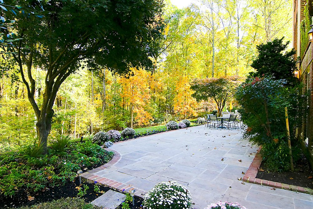 Flagstone and brick Terraces embrace the residence and the professional landscapes that feature in-ground irrigation