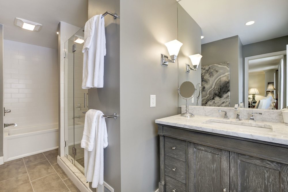 Renovated Master Bathroom with Separate Shower and Tub