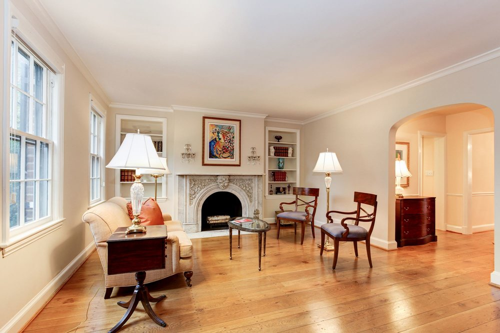 Spacious Living Room with Historic Mantle