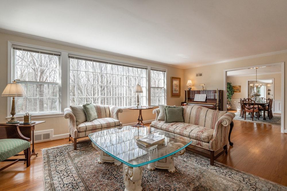 Formal Living Room overlooks Lush Rear Yard