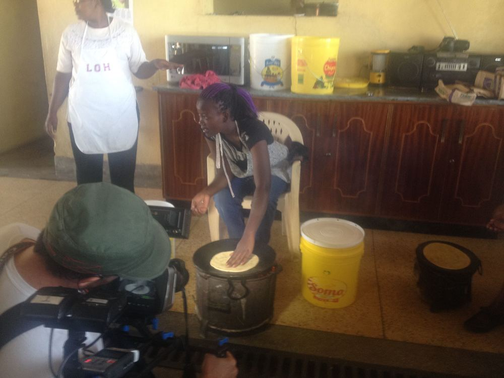 Lucas films the students frying the chapati.