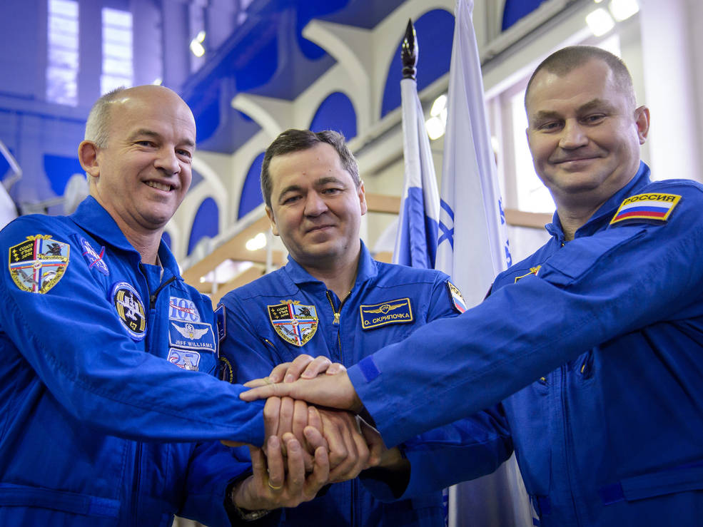Expedition 47 crew members NASA astronaut Jeff Williams, and cosmonauts Oleg Skripochka and Alexei Ovchinin of the Russian space agency Roscosmos pose for a photograph before their Soyuz qualification exams Wednesday, Feb. 24, 2016, at the Gagarin Cosmonaut Training Center in Star City, Russia. Photo Credit: NASA/Bill Ingalls