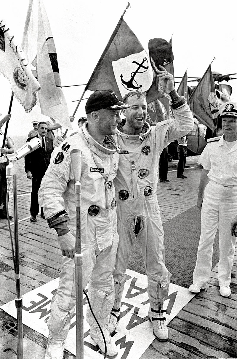 Buzz Aldrin (L) and Jim Lovell (R) aboard the U.S.S. Wasp after splashing down in the Atlantic Ocean. Photo credit: NASA