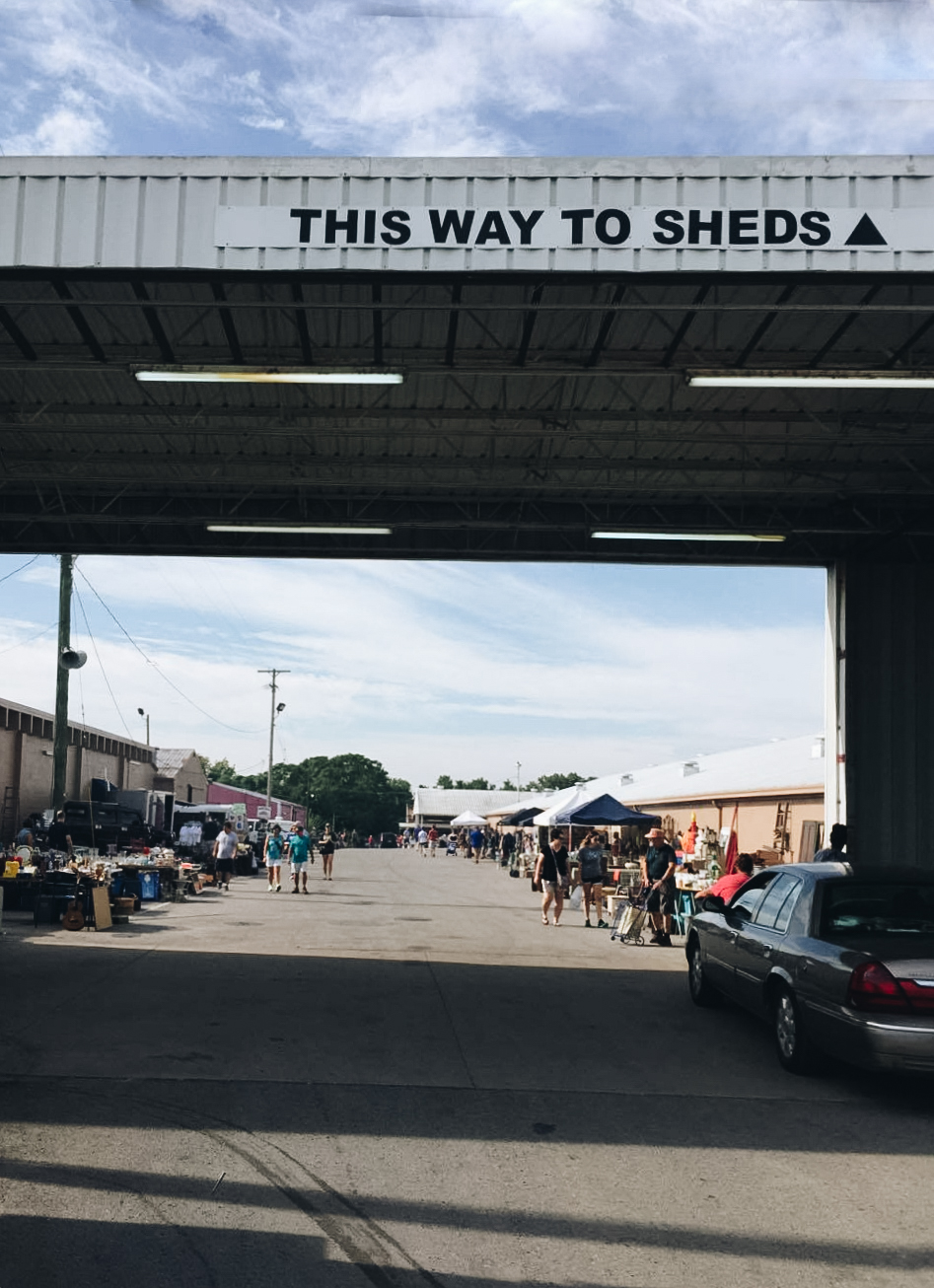 Four Sheds of Vendors strait back this way