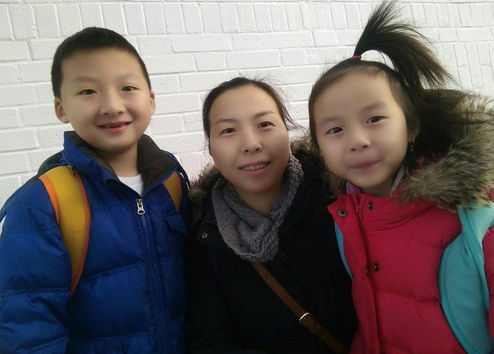[Xiao-Di Xu (mom), Kingsley Qu(2nd grader), Katherine Qu(kindergarten)]