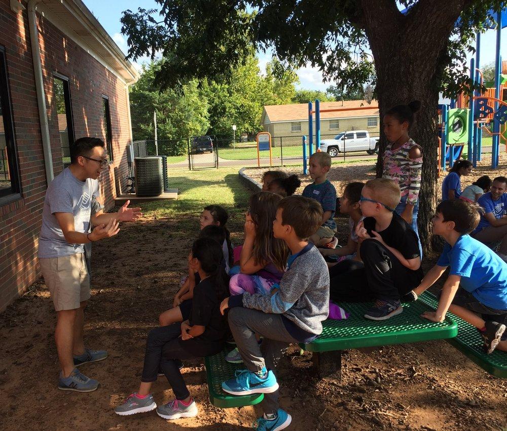 Volunteer engaging with kids, telling a story at BGCN.jpg