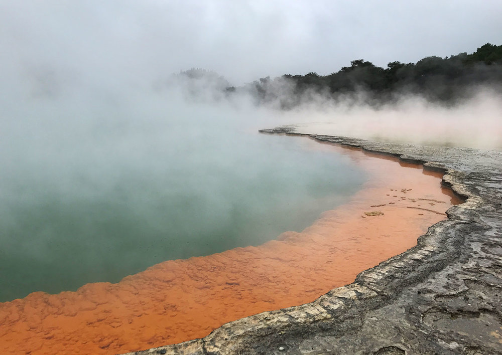 Here's another view of the Champagne Pool! Orange color indicates antimony deposits, whereas green means colloidal sulfur/ferrous salts (LOL Aka very egg-smelly).