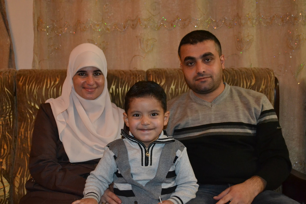 Hedaya and Sharif Sammur with their 3-year-old Zain. Hedaya was questioned by Israel's Security Agency when she tried to take Zain for treatment inside Israel.