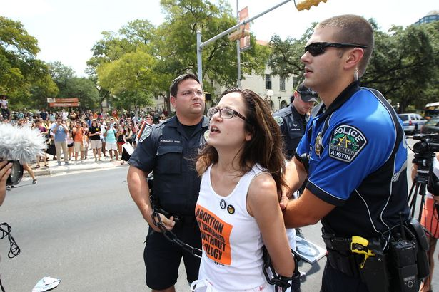 Sunsara Taylor arrested while protesting the anti-abortion law, HB2, in Texas