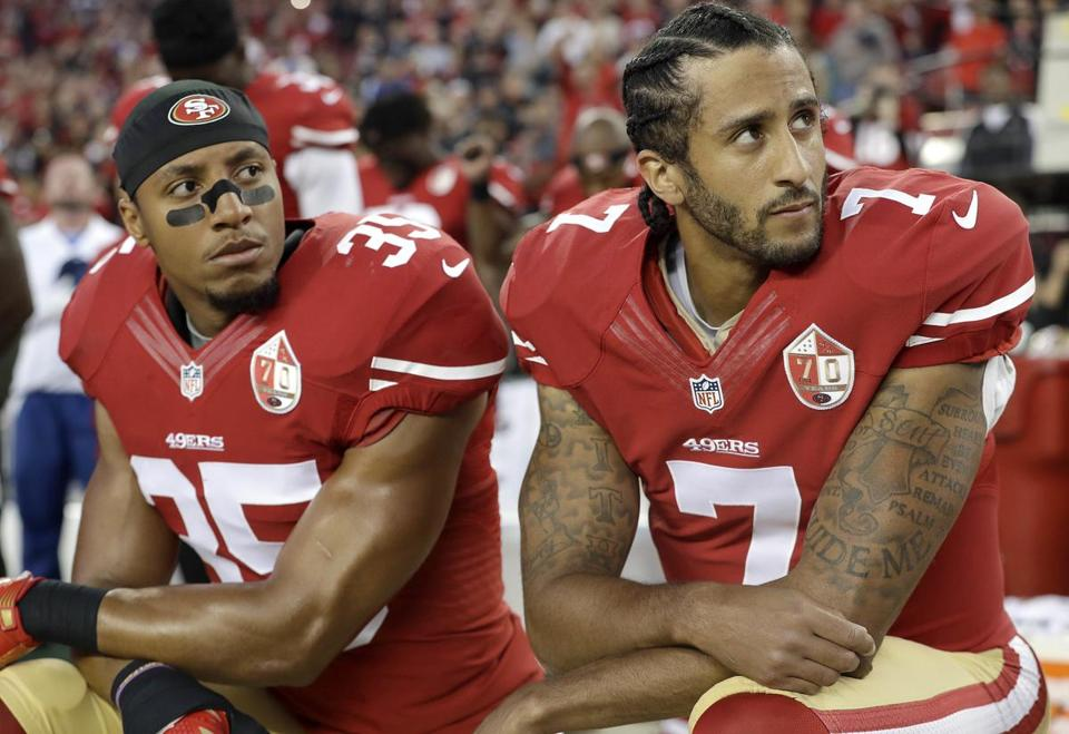 Colin Kaepernick and Eric Reid kneel during National Anthem