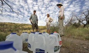 Activists leaving water for migrants crossing the desert