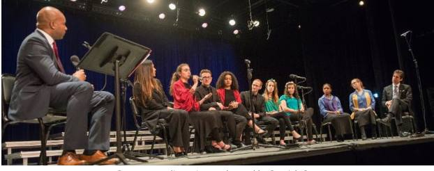 Dr. Derrick Gay moderates a panel discussion among student musicians from the Young People's Chorus of New York, Chicago Children's Chorus and the YMCA Jerusalem Youth Chorus.