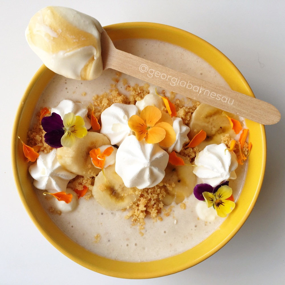 """Peering down into bowl full of beauty. I used natural morning light for a bowl full of sunshine.     """"  Banoffee Smoothie Bowl . Salted caramel greek yoghurt, frozen banana, malted milk powder and a roasted peanut crumb."""""""