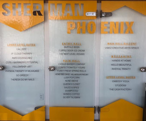 A List of Sherman Phoenix businesses at the front entrance.