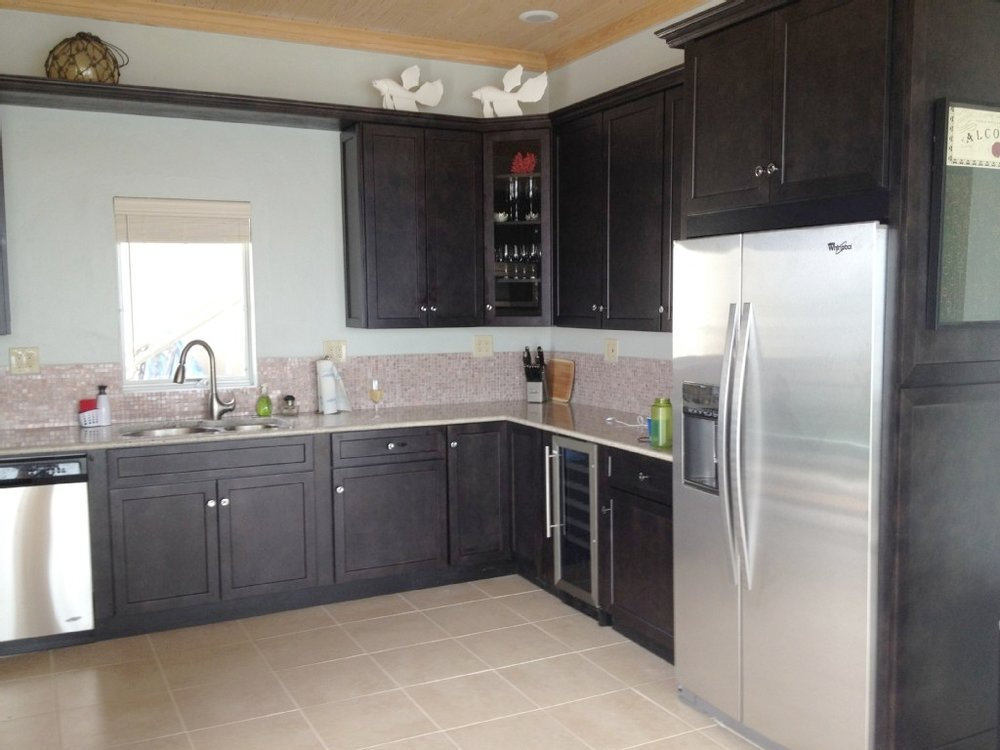 Gourmet Equipped Kitchen with every appliance ready at your fingertips. Expresso Cabinets, granite counters, stainless appliances and even a 26 bottle wine refrigerator. Everything for the chef.