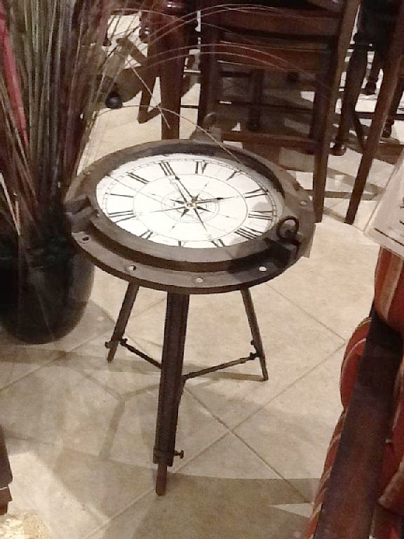 Looks like a compass, but actually a functioning clock/table. Pretty Cool Huh?