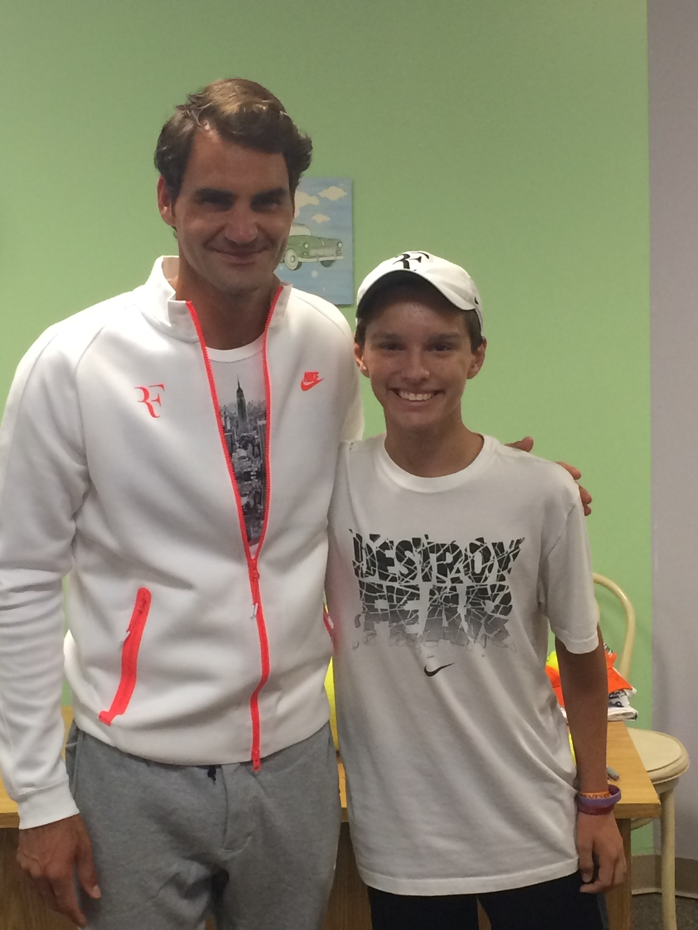 Jakob Mueller, the 2015 Rockin the Bald Rockstar, and Roger Federer at the 2015 U.S. Open. Thank you Make A Wish!