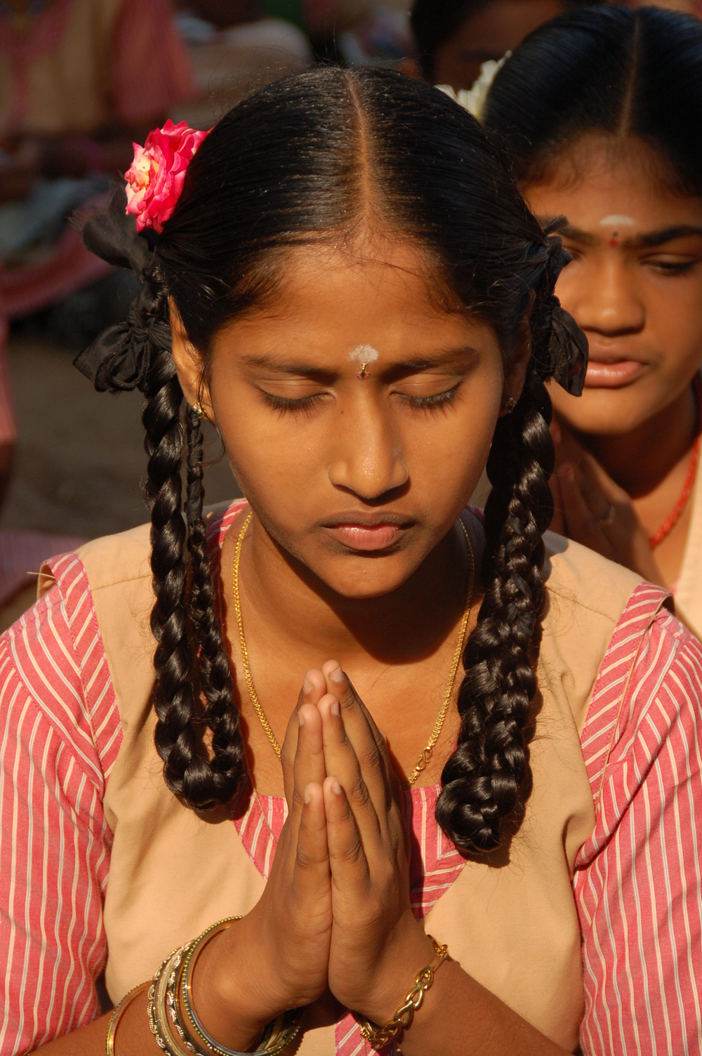 Praying school child